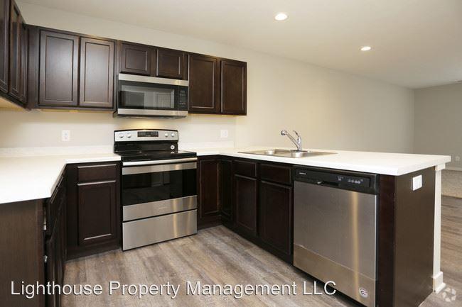 3 Bedrooms 2 Bathrooms Apartment for rent at 303 Baldwin St in Jenison, MI