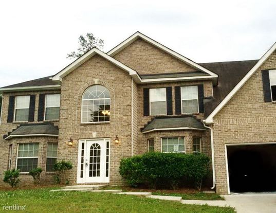 4 Bedrooms 2 Bathrooms House for rent at 1913 Boulder Gate Drive in Ellenwood, GA